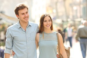Couple of tourists walking in a city street.jpg