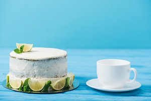 cake decorated with slices of lime n