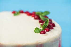 cake decorated with red currants and