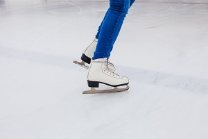 Skates on the rink. Woman on the ice