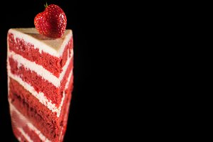piece of white and red cream cake wi