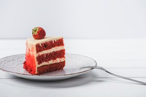 piece of red cake decorated with str