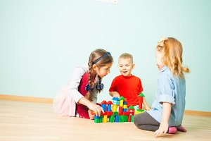 Kids play at day care. Three