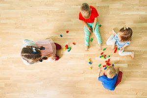 Top view of four kids constructing