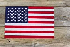 United States flag on rustic wood