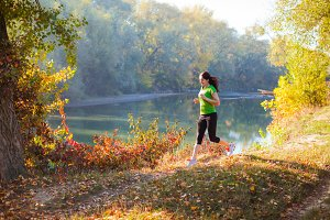 Active woman training in the autumn