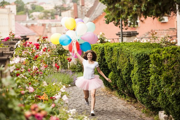 People Images - Girl with colorful latex balloons in