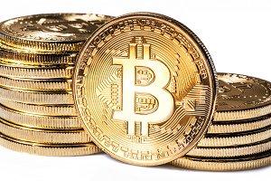 Shiny physical bitcoins isolated on
