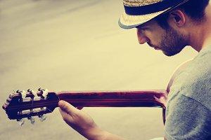 Man plays the guitar