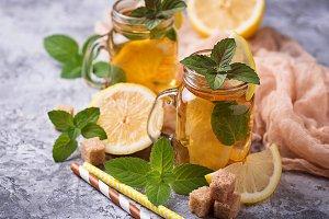 Iced tea with lemon and mint.