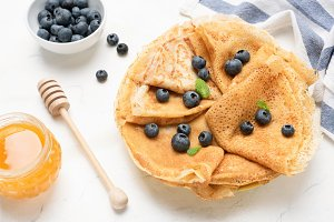 Tasty crepes with blueberries