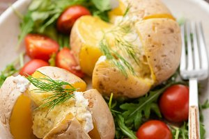 Baked potatoes stuffed with cheese