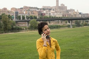 Young woman talking by mobile phone