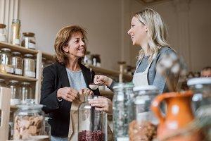 A female shop assistant serving a