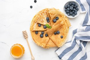 Blini or crepes with fresh berries a