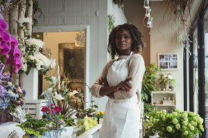 Female florist with arms crossed
