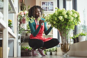 Female florist arranging flowers