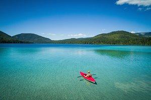 Man kayaking in lake