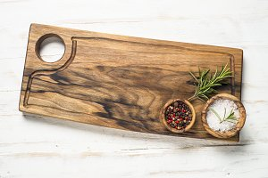 Wooden curring board and spices on