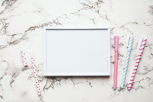 White frame and pens on marble table