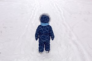 baby boy in the winter in blue