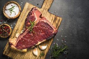 T-bone beef steak on black with