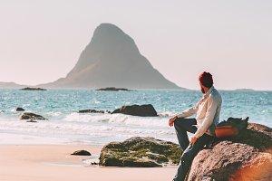 Man relaxing alone on ocean beach