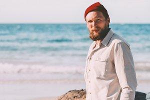 Handsome beard man walking on beach
