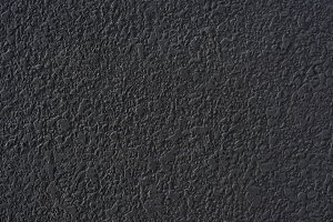 Rough black cement plastered wall