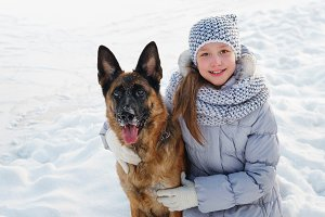 Cute girl and German shepherd.
