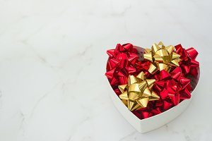Heart gift box with festive bows