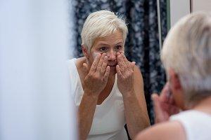 Senior woman washing her face
