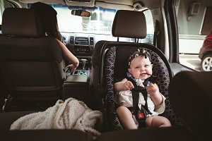 Baby sitting in child safety seat