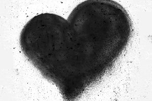 Black heart on concrete wall