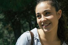 Young woman smiling in a park
