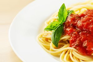 Tomato pasta served on plate with ba