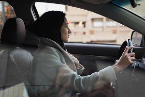 Woman in hijab driving a car