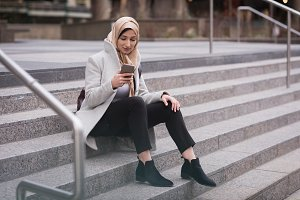 Woman in hijab using mobile phone