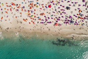 Tourist sunbathing at beach