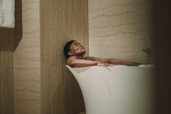 Mature woman taking bath in bathtub