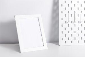 Photo frame on white table