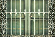 Antique wrought iron window grill by  in Architecture