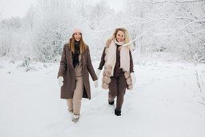 Portrait of two blonde women in hat