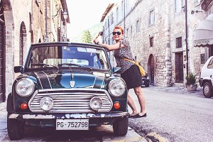 Pretty girl and a retro car