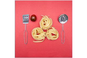 Dry pasta on a red background