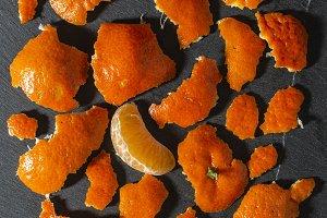 Mandarin and orange peels on a dark