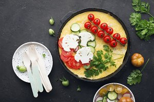 Omelette with cheese in a cast iron