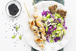 Chicken skewers with coleslaw with