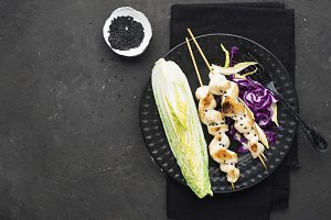 Chicken skewers with coleslaw on a