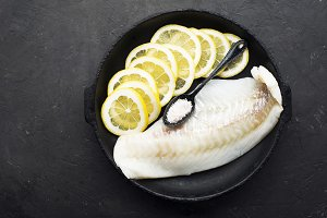 Fillet of sea white fish cod in a